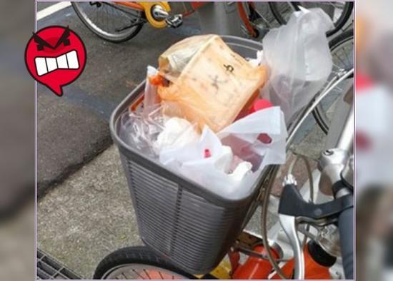 台湾共享单车车篮沦为垃圾桶网民:真丢脸